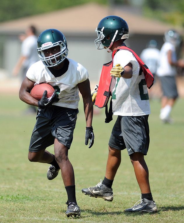 Description of . WR/DB D'Angelo Ross during morning practice at South Hills High School on Friday, Aug. 9, 2013 in West Covina, Calif.   (Keith Birmingham/Pasadena Star-News)