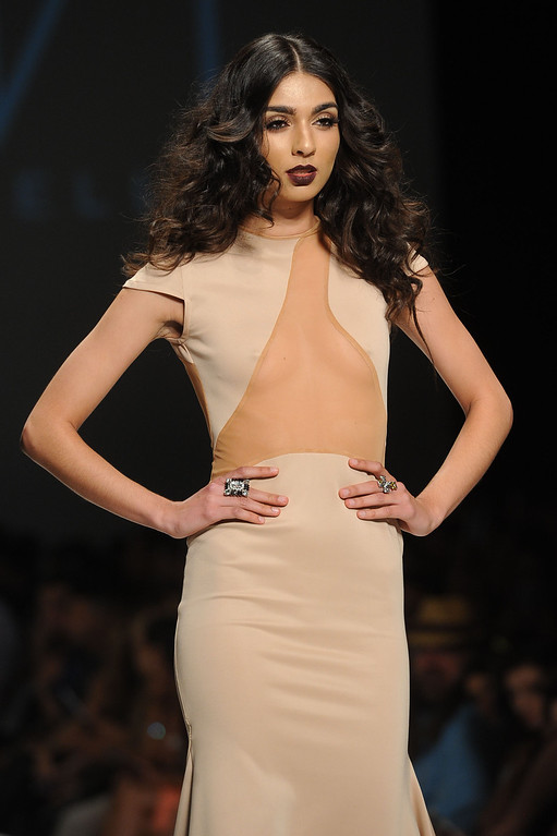 Description of . A model walks the runway at the MT Costello fashion show during L.A. Fashion Week March 10, 2014 in Los Angeles, CA.(Andy Holzman/Los Angeles Daily News)