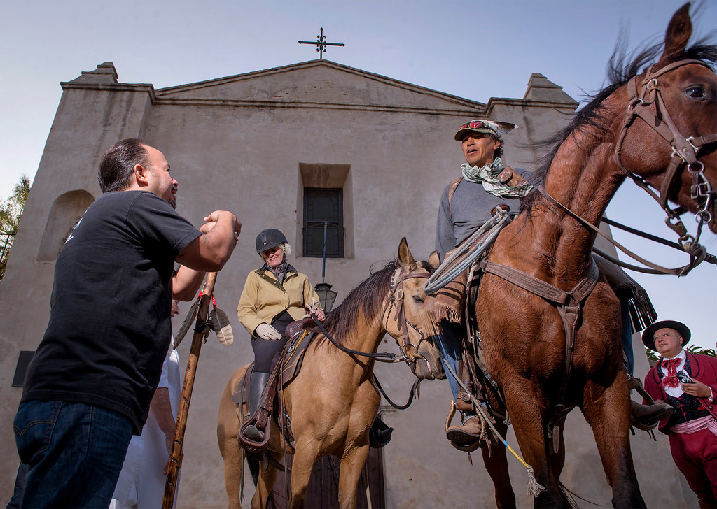Description of . Equestrians arrive at Mission San Gabriel as part of The California Mission Ride October 8, 2013.  The seven horseback enthusiasts were greeted by members of the Gabrieleño Band of Mission Indians/Kizh Nation whose forefathers built Mission San Gabriel finishing in 1771.(Staff photo by Leo Jarzomb/Pasadena Star-News)