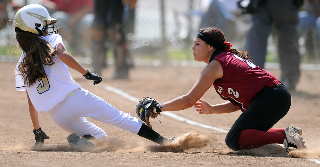 Description of . Barstow shortstop Aleesha Rodriguez (2) tags out Northview's Tyler Martinez (3) at third base in the second inning of a CIF-SS quarterfinal playoff softball game at Northview High School on Thursday, May 23, 2013 in Covina, Calif. Northview won 5-4.  (Keith Birmingham Pasadena Star-News)