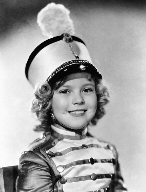 Description of . In this 1936 file photo, actress Shirley Temple is photographed as she appeared in Poor Little Rich Girl. Temple, who was born in 1928 and began acting at the age of three, received an honorary Academy Award in 1934 for her contributions as a child film star.  Shirley Temple, the curly-haired child star who put smiles on the faces of Depression-era moviegoers, died on February 10, 2014. She was 85.  http://bit.ly/1ofgU9Y  (AP Photo/File)