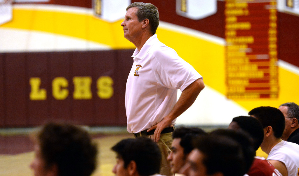 Description of . La Canada head coach Tom Hofman looks towards the scoreboard in the fourth quarter as they defeated La Salle 73-62 for coach Hofman's 600th win during a prep basketball game at La Canada High School in La Canada, Calif., on Friday, Jan. 10, 2014. Hofman record is 600 wins and 186 losses since becoming varsity head coach in the 1986-87 season. (Keith Birmingham Pasadena Star-News)