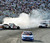 Donny Lia (81) crashes into the wall during the NASCAR Craftsman Truck Series' New Hampshire 200 auto race at New Hampshire Motor Speedway in Loudon, N.H., Saturday, Sept. 13, 2008. Ron Hornaday Jr. won the race. (AP Photo/Mike Silverwood)