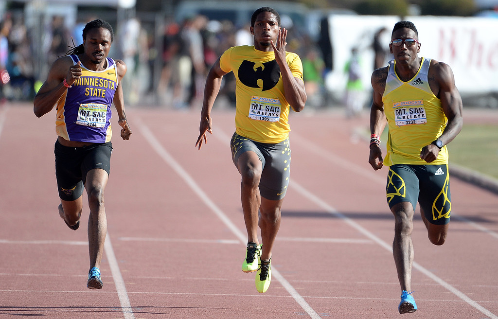 Description of . Remontay McClain, center, competes in the 200 meter Dash Invitational Elite during the Mt. SAC Relays in Hilmer Lodge Stadium on the campus of Mt. San Antonio College in Walnut, Calif., on Saturday, April 19, 2014. 