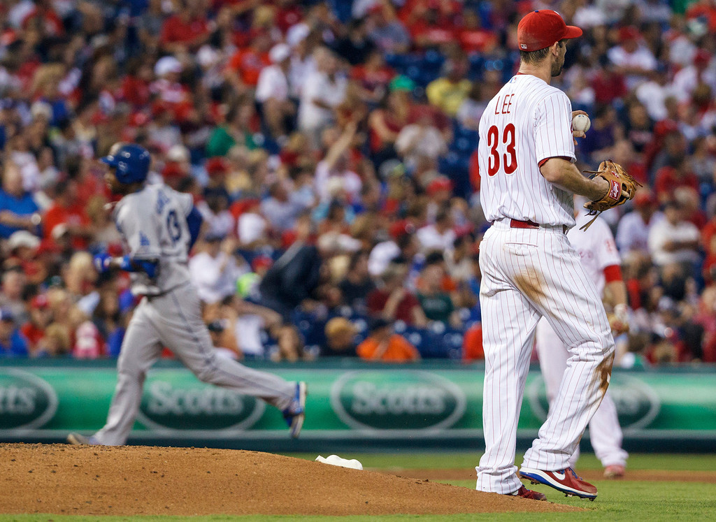 Description of . Philadelphia Phillies starting pitcher Cliff Lee waits by the mound after giving up a two-run home run to Los Angeles Dodgers' Hanley Ramirez, left, during the fourth inning of a baseball game, Friday, Aug. 16, 2013, in Philadelphia. (AP Photo/Christopher Szagola)