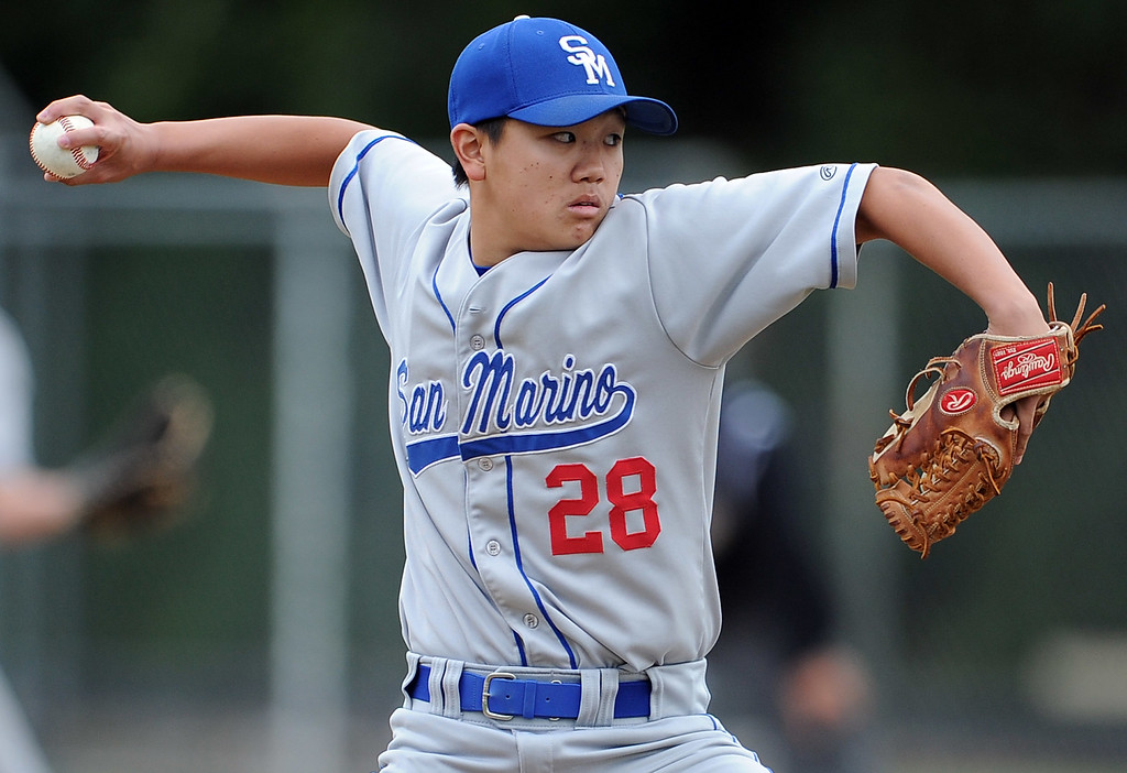 Description of . San Marino starting pitcher Jeffrey Chan throws to the plate in the first inning of a prep baseball game against La Canada at La Canada High School on Wednesday, March 8, 2013 in La Canada, Calif. La Canada won 3-2.  (Keith Birmingham Pasadena Star-News)