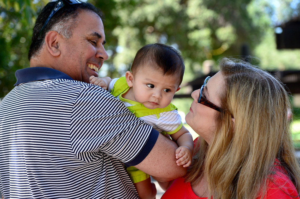 Description of . Suzy and Greg Campeau, of South Pasadena, who adopted their first child, 2-year-old Bella, last December, visit with Bella's 5-month-old brother Mason, who they had for 2 months, at their neighborhood park Saturday, May 11, 2013. This will be Suzy's first