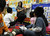 LONG BEACH, CALIF. USA -- Teacher Margarita Gutierrez reads to students at Pine Head Start in Long Beach, Calif., on February 25, 2013.  Photo by Jeff Gritchen / Los Angeles Newspaper Group
