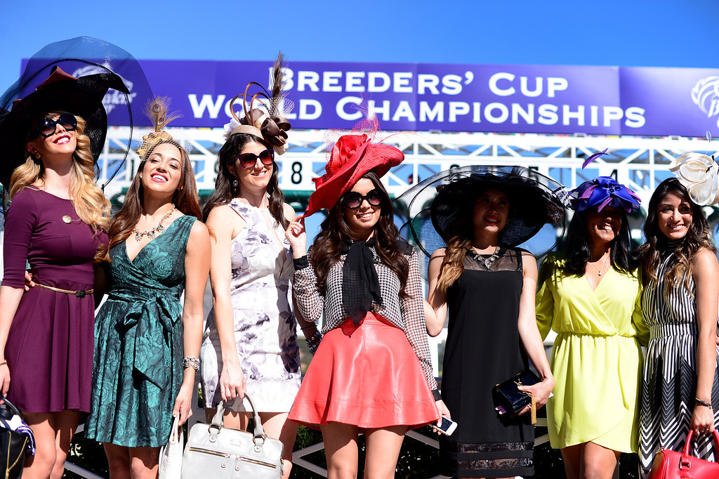 Description of . Fashion bloggers gather during the Breeders' Cup at Santa Anita Park in Arcadia Friday, November 1, 2013. (Photo by Sarah Reingewirtz/Pasadena Star-News)