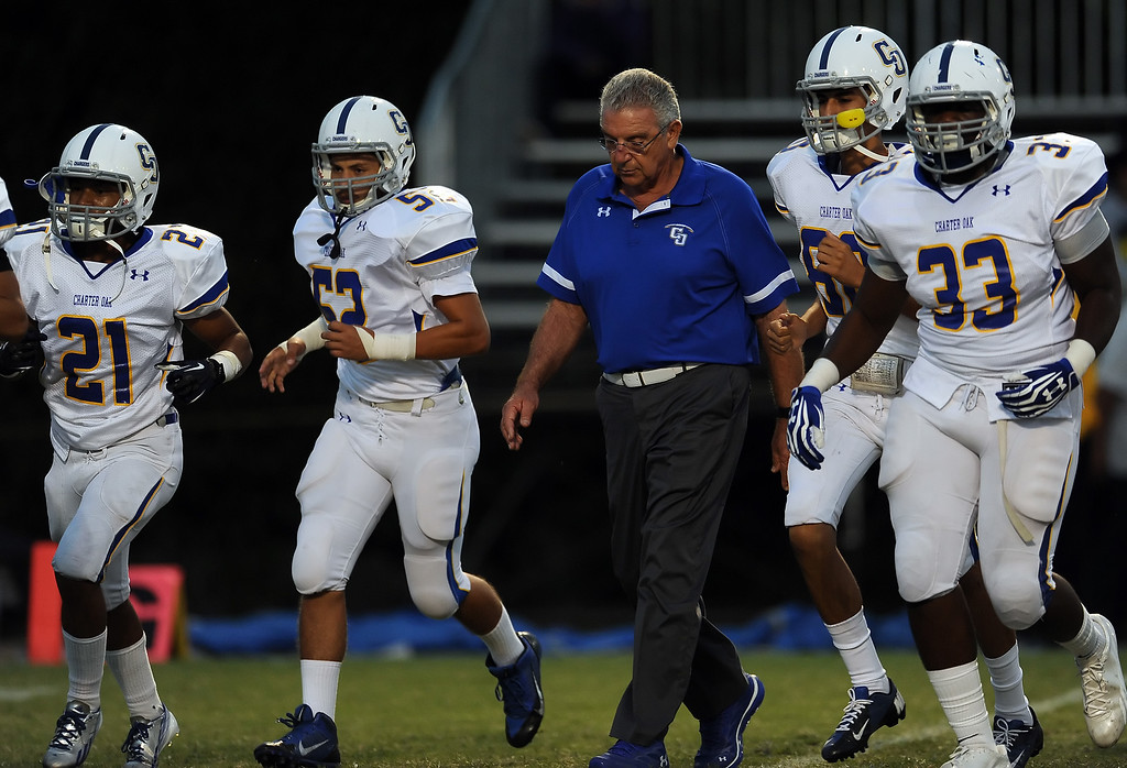 Description of . Charter Oak head coach Lou Farrar walks off the field during a prep football game against Bishop Amat at Bishop Amat High School in La Puente, Calif. on Friday, Sept. 20, 2013.    (Photo by Keith Birmingham/Pasadena Star-News)