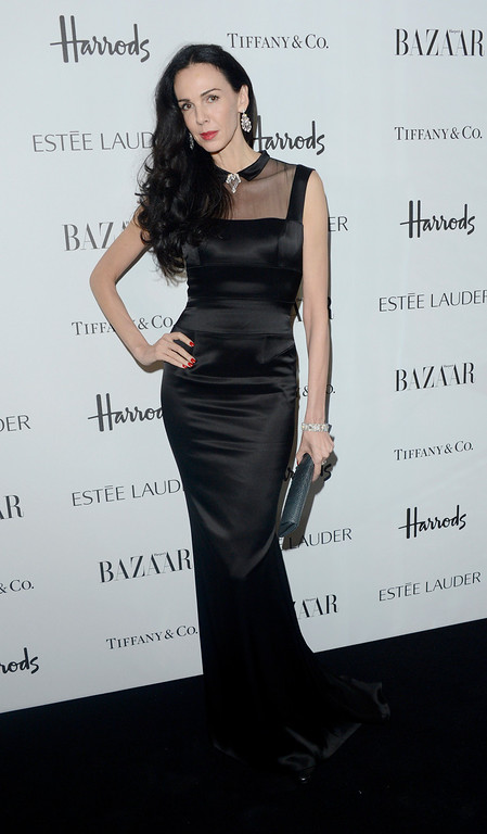 Description of . L'Wren Scott is seen at the Harper's Bazaar Woman of the Year Awards 2012 in association with Estée Lauder, Harrods and Tiffany & Co. at Claridge's Hotel on Wednesday, Oct. 31, 2012 in London. (Photo by Jon Furniss/Invision for Harper's Bazaar)