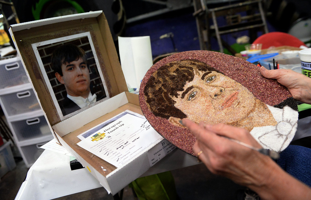 Description of . Lynne Frutchey holds a picture of Joseph Keith Wallace who's likeness along with 80 others will be on the