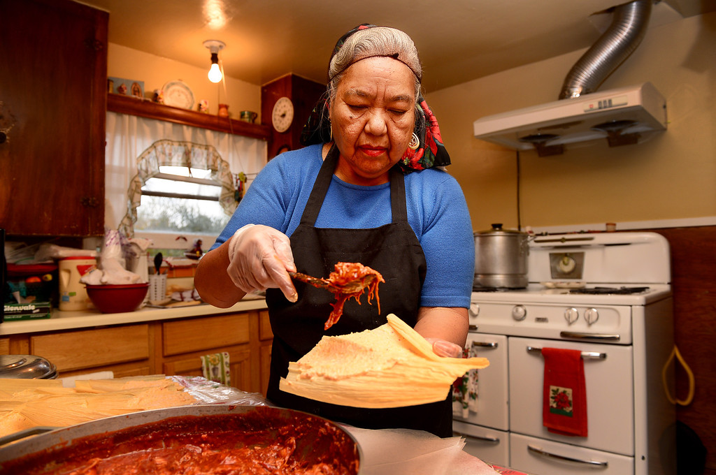 Description of . Santos Garza, 68, makes chicken Christmas tamales for friends and family Saturday, December 21, 2013 in her Rosemead home that she shares with her 83-year-old husband Emede. Garza expects to make 18 dozen chicken, cheese and pork tamales this year. Tamales are a Christmas Eve tradition in Mexico. (Photo by Sarah Reingewirtz/Pasadena Star-News)