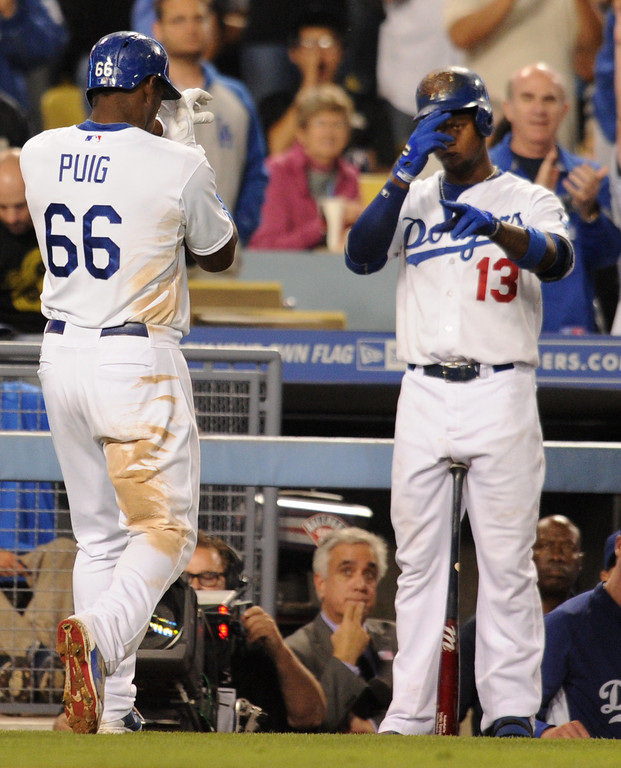 Description of . Yasiel Puig is congratulated by Hanley Ramirez on his home run in the 7th inning. The Los Angeles Dodgers lost 4-1 to the Arizona Diamondbacks in a game at Dodger Stadium in Los Angeles, CA. 9/11/2013. photo by (John McCoy/Los Angeles Daily News)