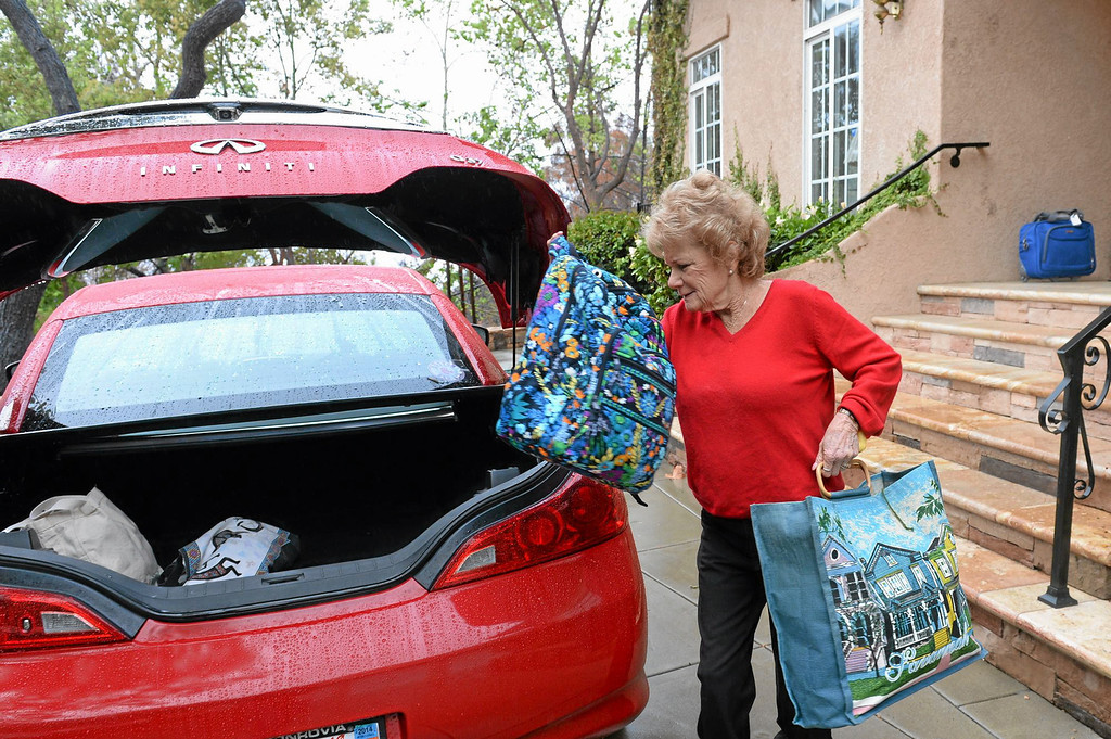 Description of . Sue Johnson packs her belongings on Englewild Lane in Glendora in preparation of the oncoming storm on Thursday February 27, 2014. (Staff Photo by Keith Durflinger/San Gabriel Valley Tribune)
