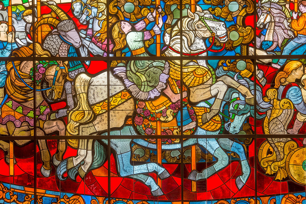 "Description of . PIH Health has purchased the former Montebello, Calif. Home Savings and Loan to use as an urgent care facility.  Two historic items, a stained glass window, ""The Carousel"", pictured, designed by Susan Hertel and fabricated by John Wallis and Associates on the south façade, and a mosaic mural,"