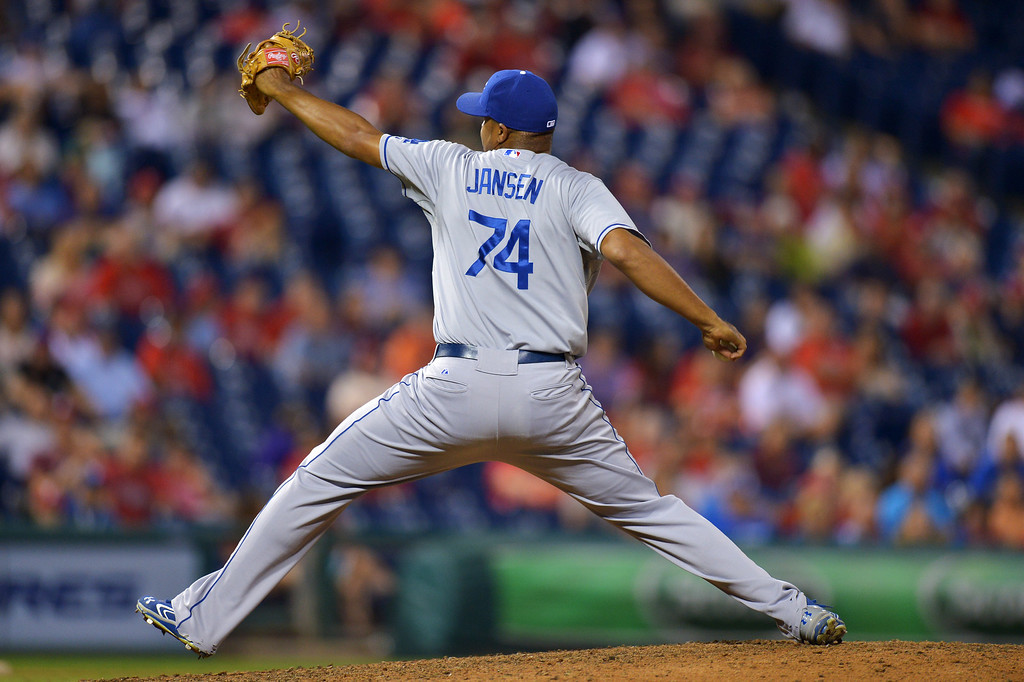 Description of . PHILADELPHIA, PA - AUGUST 16: Kenley Jansen #74 of the Los Angeles Dodgers delvers a pitch in the ninth inning against the Philadelphia Phillies at Citizens Bank Park on August 16, 2013 in Philadelphia, Pennsylvania. The Dodgers won 4-0. (Photo by Drew Hallowell/Getty Images)