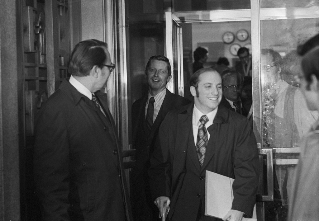 Description of . Herbert Miller, left, attorney for former President Richard M. Nixon, holds the door open for Special Watergate prosecutor Henry Ruth as they leave the U.S. Court of Appeals in Washington, Feb. 1, 1975.  Miller asked the court to stay a lower court's ruling on ownership of presidential papers.  (AP Photo/Charles Harrity)