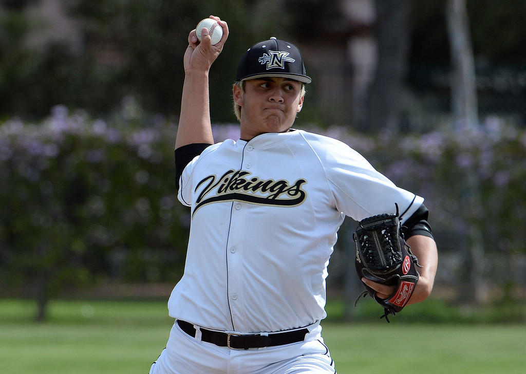 Description of . Northview starting pitcher James Ramos throws to the plate against San Dimas in the first inning of a prep baseball game at Northview High School in Covina, Calif., on Wednesday, March 26, 2014. San Dimas won 2-0.