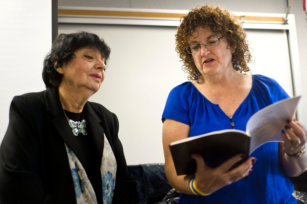 Description of . Art teacher Elaine Stricklin, right, gives a book of poems inspired by Inge Auerbacher, left, poetries during her visit at Sierra High School in Glendora on Tuesday, Nov. 12, 2013. Auerbacher told her stories about the time she spent in the Terezin concentration camp. (Photo by Watchara Phomicinda/San Gabriel Valley Tribune)