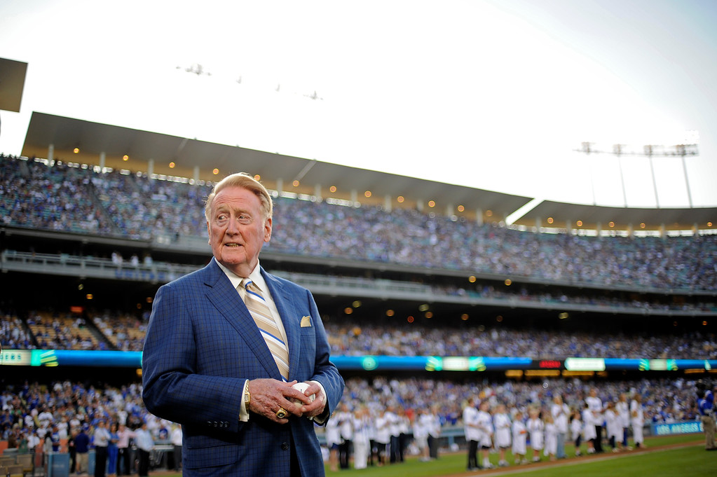 Description of . Vin Scully waits to throw out the first pitch on  Vin Scully Bobblehead Night at Dodger Stadium in Los Angeles Thursday, August 30, 2012. (Hans Gutknecht/Staff Photographer)