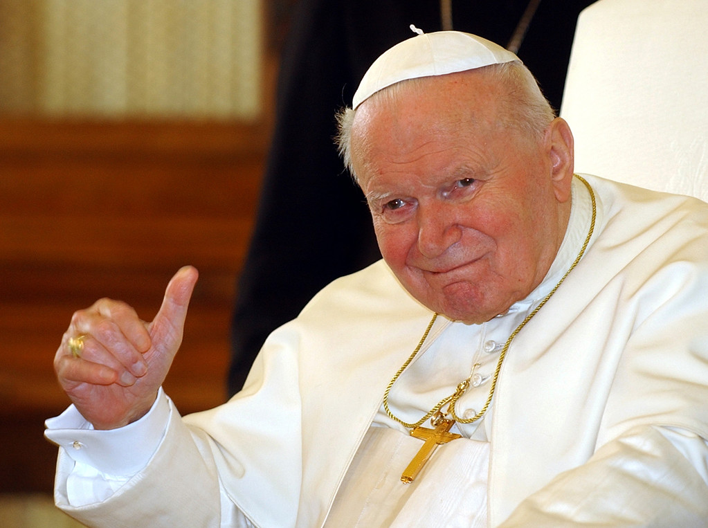 Description of . Pope John Paul II gestures during his meeting with Armenia's President Robert Kocharian, unseen, at the Vatican, Friday, Jan. 28, 2005. Pope John Paul II told Kocharian that the Holy See supports all efforts for a peace settlement in the disputed  enclave of Nagorno-Karabakh. (AP Photo/Plinio Lepri)