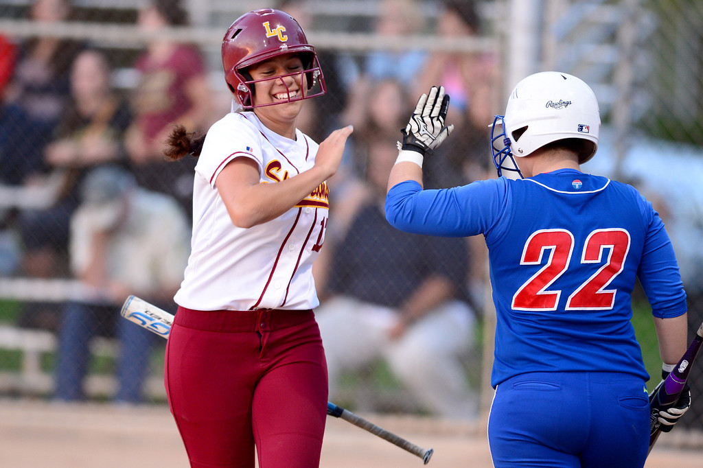 Description of . La Canada's Olivia Leyva (17) high fives San Gabriel's Jennifer Hoang (22) during the West SGV softball all-star game Wednesday night, June 11, 2014 at Live Oak Park in Temple City. (Photo by Sarah Reingewirtz/Pasadena Star-News)