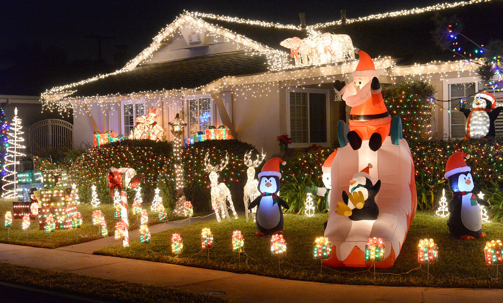 Description of . Holiday lights on display on the 15800-block of Greenworth Drive in La Mirada on Friday December 20, 2013.  (Staff Photo by Keith Durflinger/Whittier Daily News)