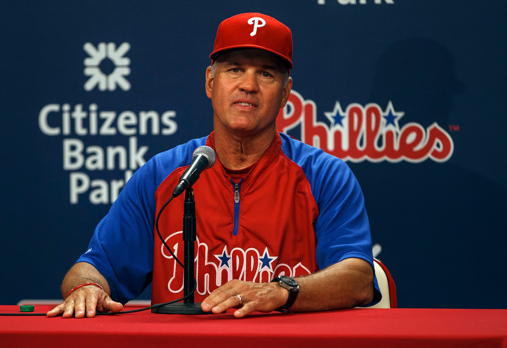 Description of . Philadelphia Phillies' Ryne Sandberg takes questions from reporters after being announced as manager during a news conference before a baseball game against the Los Angeles Dodgers, Friday, Aug. 16, 2013, in Philadelphia. Charlie Manuel was fired as manager of the Phillies on Friday and replaced by Hall of Famer and former Cubs second baseman Ryne Sandberg, the Phillies' third-base coach. (AP Photo/