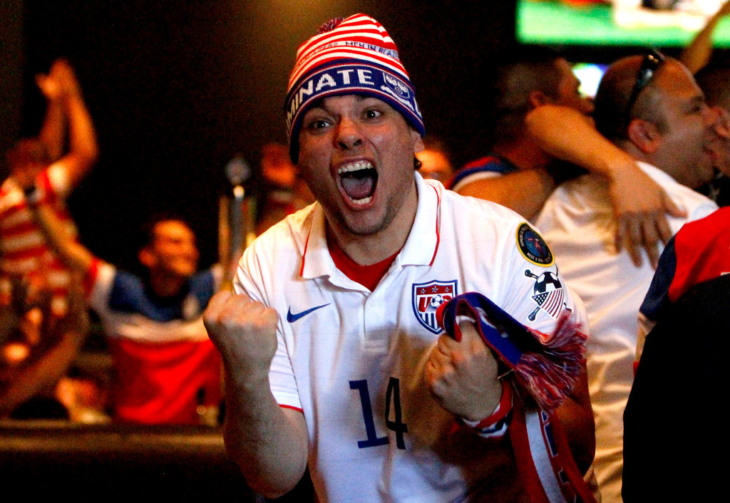 Description of . Antonio Borjon, of Lake Elisnore, celebrates after team USA goes up 2-1 during a World Cup match against Ghana on Monday, June 16, 2014 at Dave and Busters in Ontario, Ca. (Micah Escamilla/Inland Valley Daily Bulletin)