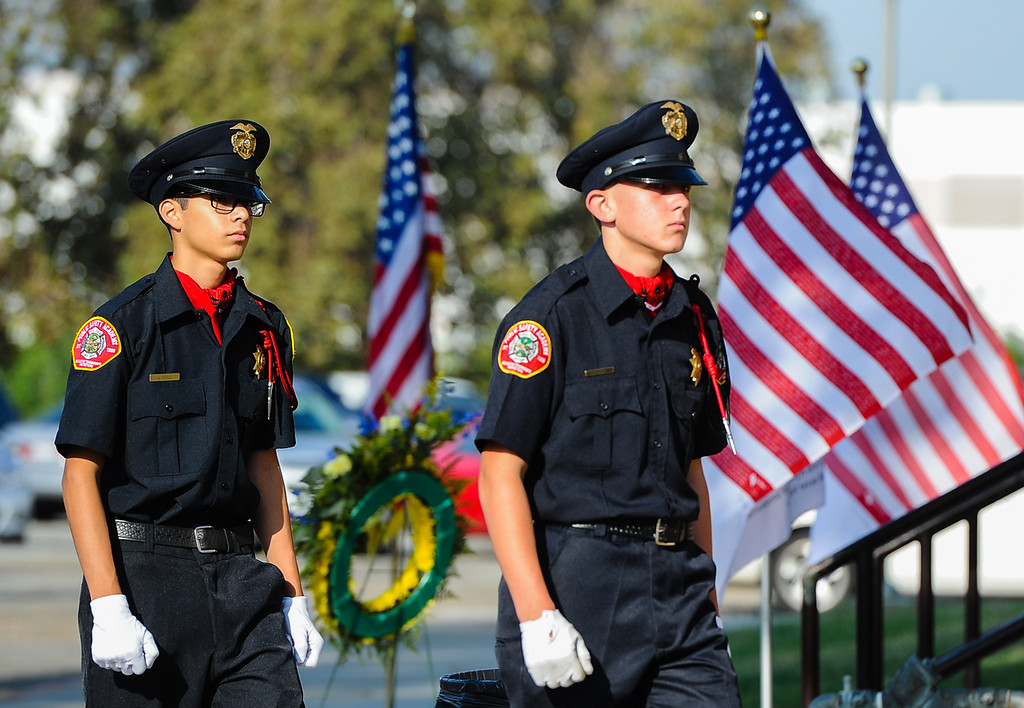 Description of . Young cadets pay tribute to those who lost their lives in the 9/11 terrorism attacks during a 9/11 remembrance ceremony at the Public Safety Academy in San Bernardino on Wednesday, Sept. 11, 2013. (Photo by Rachel Luna / San Bernardino Sun)