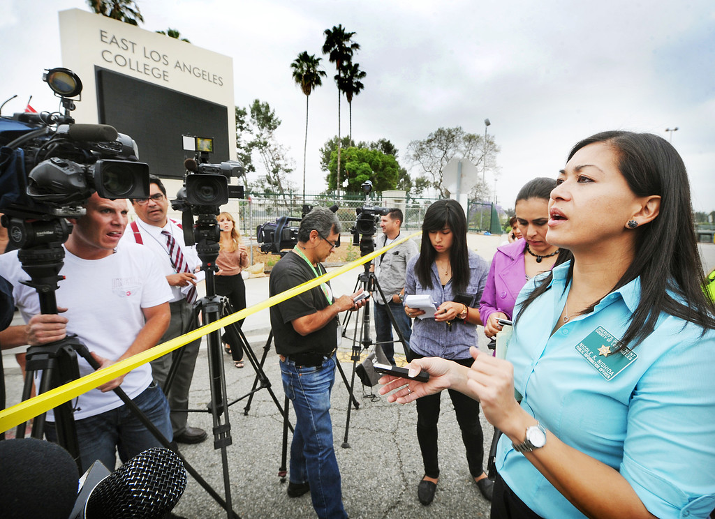 Description of . Los Angeles Sheriff's spokesperson, Nicole Nishida informing media on threat at East Los Angeles College.  A 19-year-old man was arrested for allegedly making phone calls to the California Highway Patrol threatening gun violence against local schools on Thursday, May 16, 2013. When the suspect called to make the threat, he said he was en route to a college in Monterey Park, she said. The call was made from a cell phone and was received from the East Los Angeles and Monterey Park areas, officials said.About 14 schools were locked down during the incident. At about 9:30 a.m., Santa Monica Community College police arrested a suspect, a 19-year old male in connection with this threat as well as the Santa Monica threat,