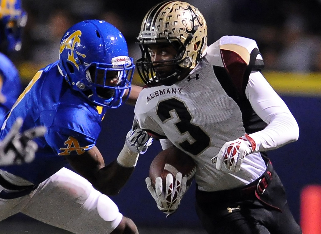 Description of . Alemany's Brandon Boyd (3) runs for a first down against Bishop Amat in the first half of a prep football game at Bishop Amat High School in La Puente, Calif., on Friday, Oct. 25, 2013.    (Keith Birmingham Pasadena Star-News)