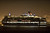 LONG BEACH, CALIF. USA -- The youngest Cunard Line ship, Queen Elizabeth, heads out of Long Beach (Calif.) Harbor after visiting the Queen Mary on March 12, 2013. The Queen Mary was built by Cunard in 1936 and retired in 1967. The Queen Mary, now a permanently berthed, is a hotel and special events venue. The two ships exchanged whistle blows.  