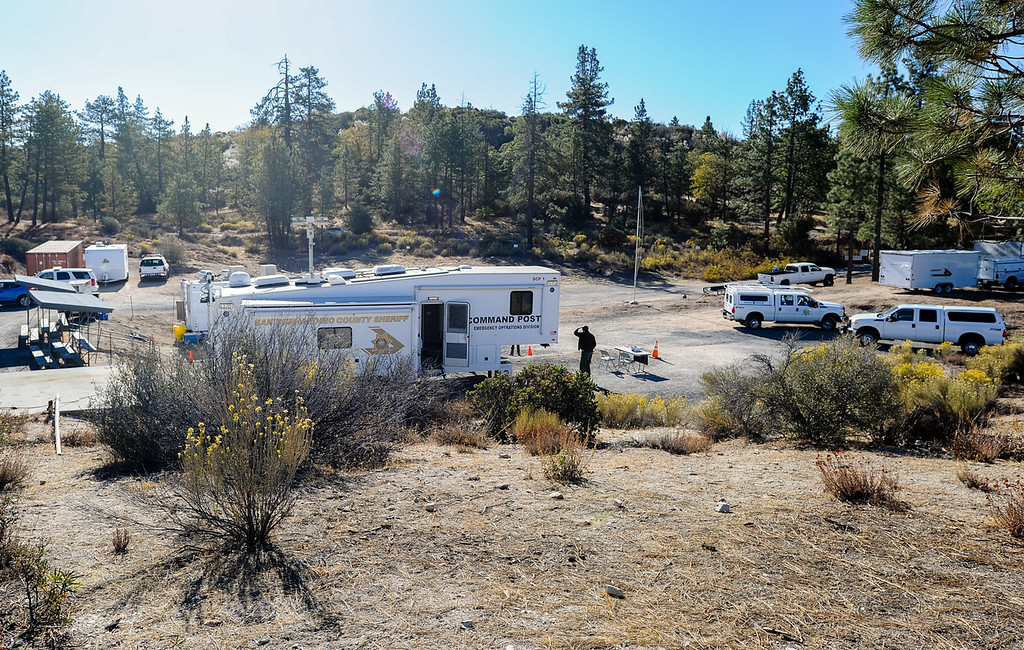 Description of . San Bernardino County Sheriff's Department set up a command post at the Arrowhead Fish & Game Conservation Club as the search for missing German hiker continues in the San Bernardino Mountains near Lake Arrowhead on Friday, Oct. 4, 2013. The command post is adjacent to the Pinnacle Trailhead. (Photo by Rachel Luna / San Bernardino Sun)