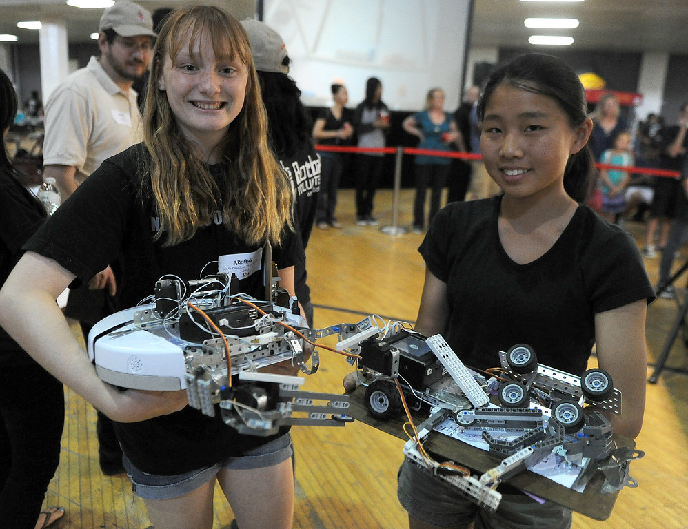 Description of . South Pasadena High School students fourteen year-old Helena Roberts-Mataric, left, with teammate fourteen year-old Karen Zhu during the Botball Regional Tournament, part of standards-based educational robotics program. Part of a national program to encourage kids to study math, science. Kids from schools in LA County will compete to see who built best robot at the Shrine Expo Hall on Saturday, March 4, 2013 in Los Angeles.    (Keith Birmingham Pasadena Star-News)