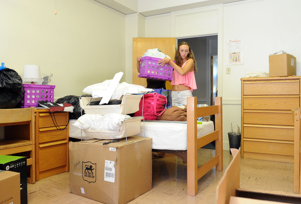 Description of . (John Valenzuela/Staff Photographer) Freshman student Shannon Price of Temecula, unpacks her belongings, Wednesday morning during move-in day at the University of Redlands, August 28, 2013.