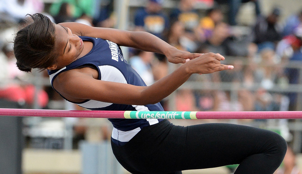 Description of . Redland's Alisha Edwards competes in the division 2 high jump during the CIF Southern Section track and final Championships at Cerritos College in Norwalk, Calif., Saturday, May 24, 2014. 