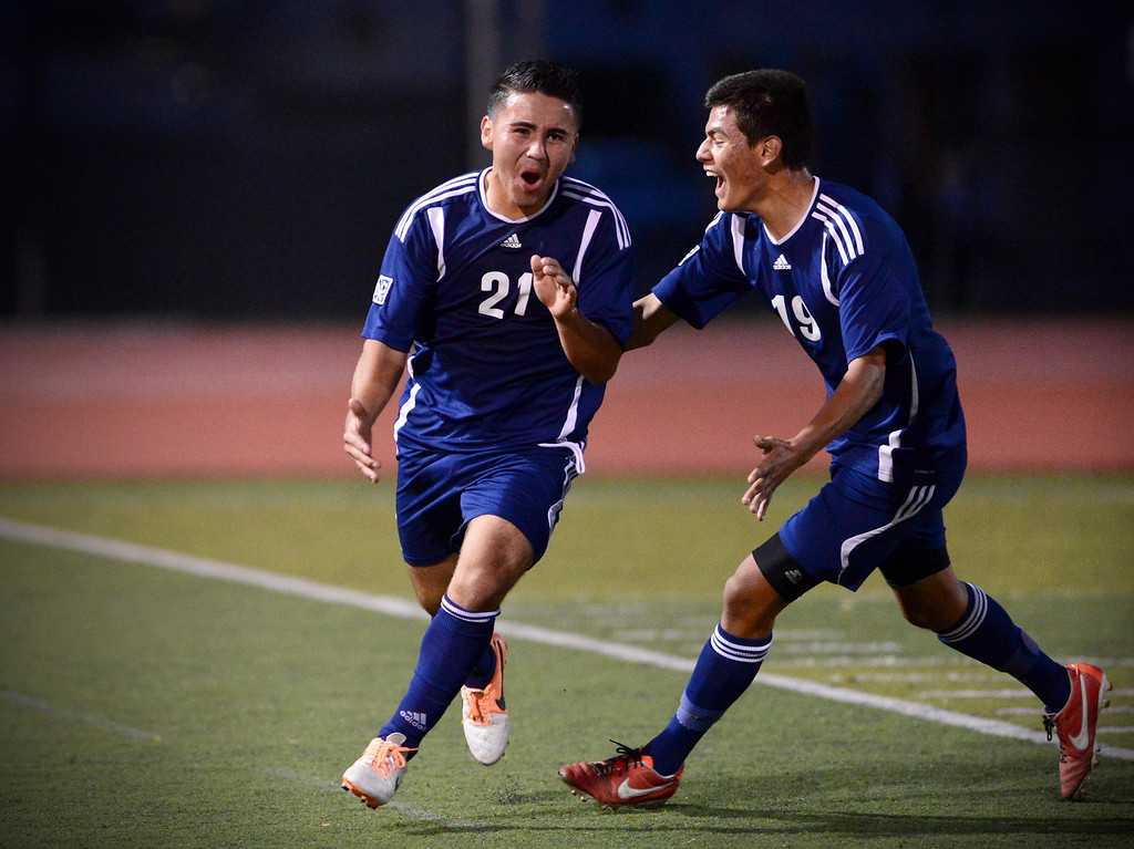 Description of . Anaheim's Francisco Santana (21) and Daniel Viral (19) celebrate their second goal as they defeat Arcadia 2-0 during the quarterfinals at Arcadia High School Thursday, February 27, 2014. (Photo by Sarah Reingewirtz/Pasadena Star-News)