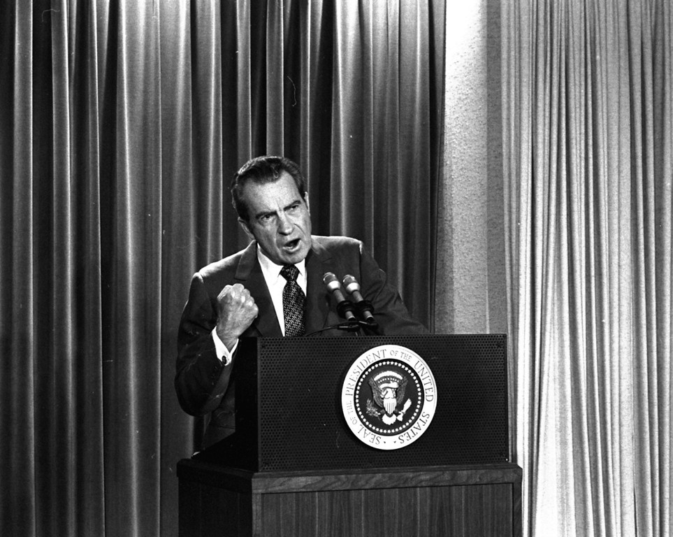 Description of . President Nixon tells White House newsmen, March 15, 1973, that he will not allow his legal counsel, John Dean, to testify on Capitol Hill on the Watergate investigation.  (AP Photo/Charlie Tasnadi)