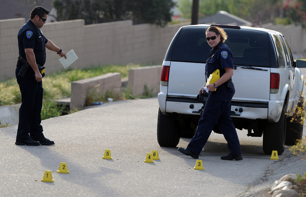 Description of . San Bernardino Police officials investigate the scene of a shooting in the 3300 block of east Love Lane in San Bernardino, CA, Wednesday, March 5, 2014. (Photo by Jennifer Cappuccio Maher/Inland Valley Daily Bulletin)