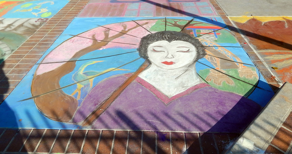 """Description of . The annual Chalk Art Festival was a success. About 200 middle and high school kids were expected to participate and about 400 showed up. Many students chose to create art that followed the """"Japanese Garden"""" theme but others tried to create pieces inspired by this year's Together We Read title, """"Farewell to Manzanar.""""  (Photo by Monica Rodriguez/Inland Valley Daily Bulletin)"""