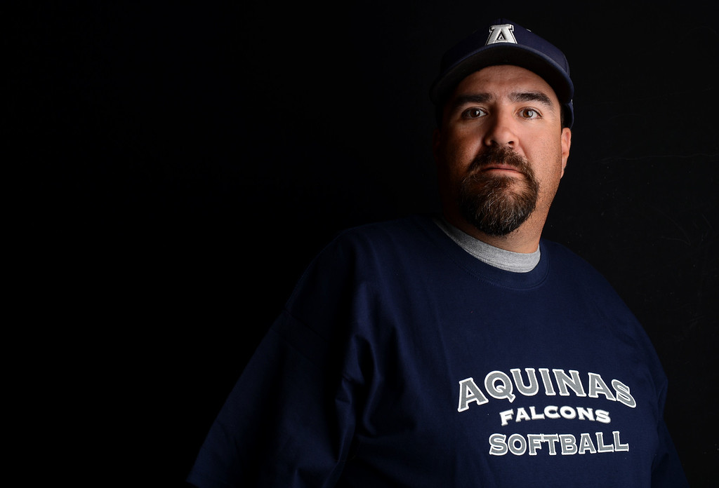 Description of . Chris Ybarra has been named Coach of the Year to The Sun's All-Area softball team. Ybarra is the softball coach for Aquinas High School. Jennifer Maher staff photo The Sun.