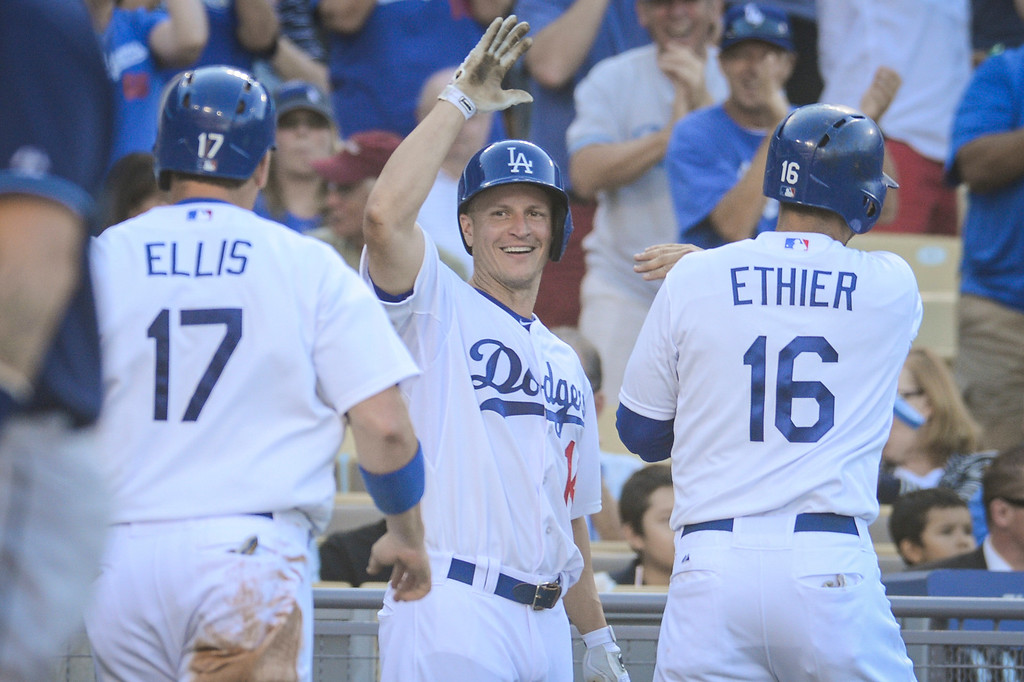 Description of . Dodger's Mark Ellis greets A.J. Ellis and Andre Ethier as they scored against the Rays during 3rd inning action at Dodger Stadium Sunday, August 11, 2013.  Dodgers won 8-2.  Photo by David Crane/Los Angeles Daily News