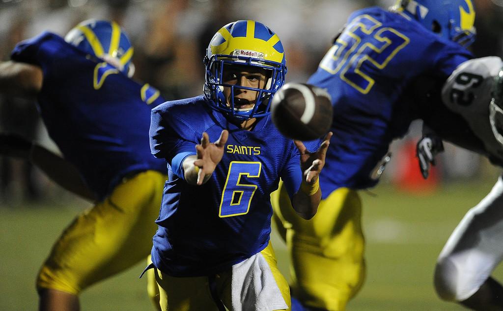 Description of . San Dimas quarterback Josh Avila (6) shuffle passes against Bonita in the first half of a prep football game at Citrus College on Thursday, Aug. 29, 2013 in Glendora, Calif.   (Keith Birmingham/Pasadena Star-News)