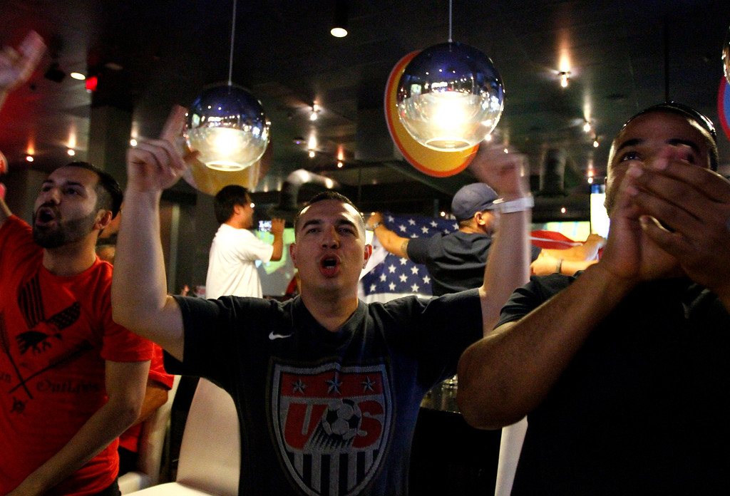 Description of . Fans watch the USA vs Ghana world cup soccer match on Monday, June 16, 2014 at Dave and Busters in Ontario, Ca. (Micah Escamilla/Inland Valley Daily Bulletin)