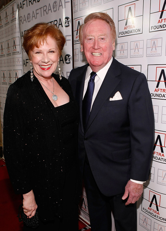 Description of . LOS ANGELES, CA - MARCH 09:  Roberta Reardon, AFTRA President, and Vin Scully, Los Angeles Dodgers announcer, arrive at the 2009 AFTRA Media and Entertainment Excellence Awards at the Biltmore Hotel on March 9, 2009 in Los Angeles, California.  (Photo by Michael Buckner/Getty Images)