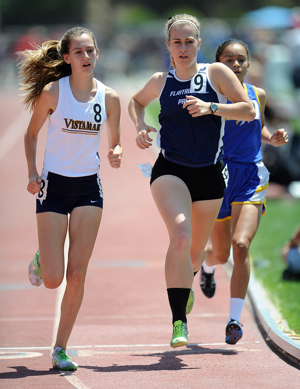 Description of . Flintridge Prep's Kate Evans in the 1600 meters race during the CIF-SS track & Field championship finals in Hilmer Stadium on the campus of Mt. San Antonio College on Saturday, May 18, 2013 in Walnut, Calif.  (Keith Birmingham Pasadena Star-News)