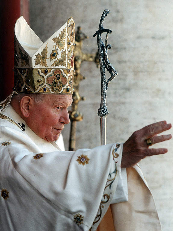 Description of . Pope John Paul II delivers his traditional blessing