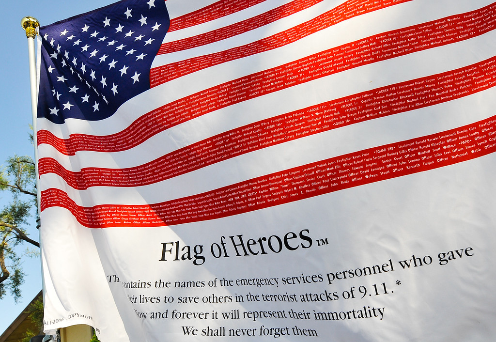 Description of . American flags written with the names of first responders who gave their lives in the 9/11 terrorist attacks are displayed during a 9/11 remembrance ceremony at the Public Safety Academy in San Bernardino on Wednesday, Sept. 11, 2013. (Photo by Rachel Luna / San Bernardino Sun)